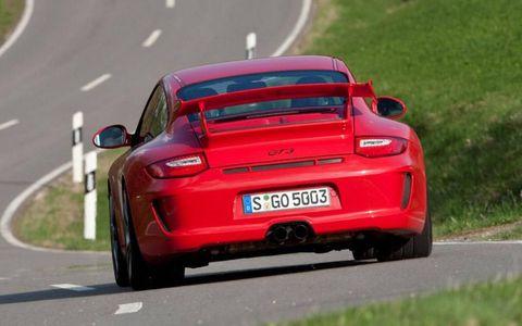 Road, Automotive design, Vehicle registration plate, Vehicle, Infrastructure, Performance car, Red, Road surface, Car, Asphalt,
