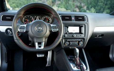 Inside the 2012 Volkswagen Jetta GLI sedan is fitted for fun with large-bolster sport seats, flat-bottom steering wheel and contrasting red stitching.