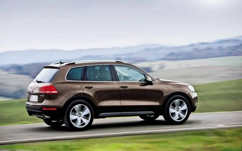 A 2012 Volkswagen Touareg TDI LUX passes by.