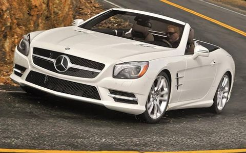 A front view of the 2013 Mercedes-Benz SL550 with the roof open.