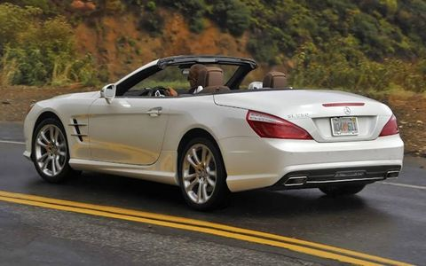 A rear view of the 2013 Mercedes-Benz SL550 with the roof open.