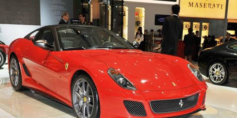 Tire, Wheel, Automotive design, Land vehicle, Vehicle, Event, Performance car, Car, Red, Personal luxury car,