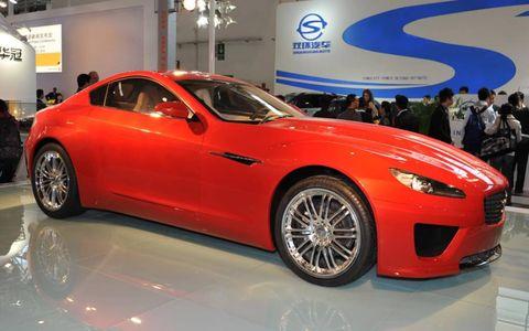 Tire, Wheel, Automotive design, Vehicle, Land vehicle, Event, Automotive tire, Car, Alloy wheel, Automotive wheel system,