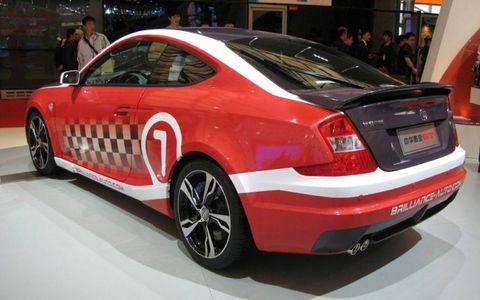 Tire, Wheel, Automotive design, Vehicle, Automotive wheel system, Alloy wheel, Red, Vehicle registration plate, Car, Spoke,