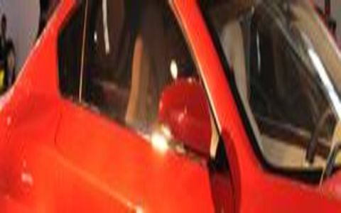 Motor vehicle, Mode of transport, Automotive design, Red, Orange, Vehicle door, Steering wheel, Carmine, Steering part, Maroon,