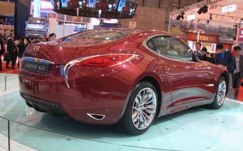 Tire, Mode of transport, Automotive design, Vehicle, Land vehicle, Car, Personal luxury car, Automotive lighting, Auto show, Vehicle registration plate,