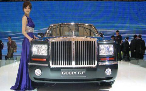 Vehicle, Automotive design, Event, Automotive exterior, Grille, Car, Formal wear, Automotive lighting, Luxury vehicle, Exhibition,