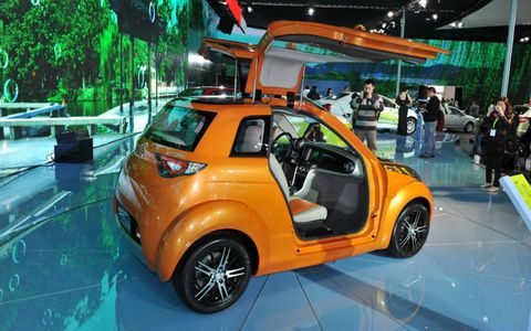 Motor vehicle, Automotive design, Vehicle, Car, Auto show, Exhibition, Alloy wheel, Automotive mirror, Hatchback, City car,