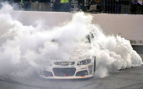 Kevin Harvick celebrates with a burnout at Richmond.