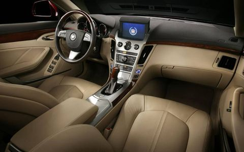The interior of the 2013 Cadillac CTS AWD Sedan has an optional hide away navigation screen that raises from the center stack.