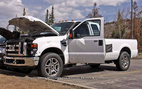 The F-350 is spied with doors and hood open.