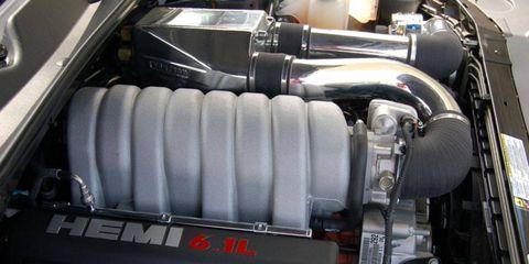 Motor vehicle, Engine, Personal luxury car, Automotive engine part, Automotive air manifold, Automotive super charger part, Luxury vehicle, Kit car, Machine, Fuel line,