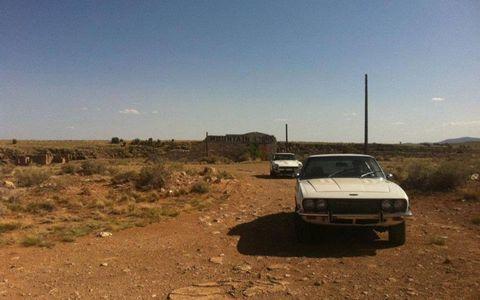 The Jensen Interceptor and Datsun 280Z at a long overdue stop.