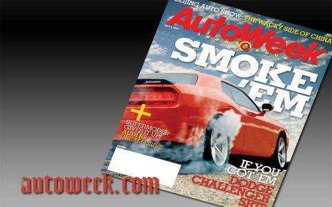 Publication, Orange, Automotive tail & brake light, Automotive lighting, Advertising, Performance car, Bumper, Luxury vehicle, Personal luxury car, Sedan,