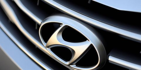 Hyundai is cutting spending for such things as business flights and hotels after executives took a 10 percent pay cut in October.