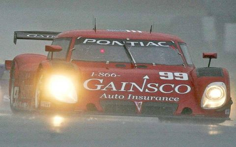The #99 Pontiac Pontiac Riley of Jon Fogarty and Alex Gurney races in the rain.