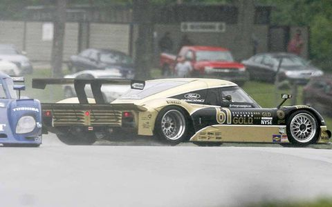 The #61 Ford Riley of Brian Friselle and Mark Wilkins spins in the rain.
