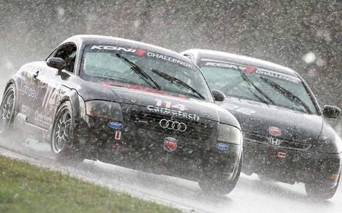 Audi TT of Don Istook and Colin Cohen races in the rain.