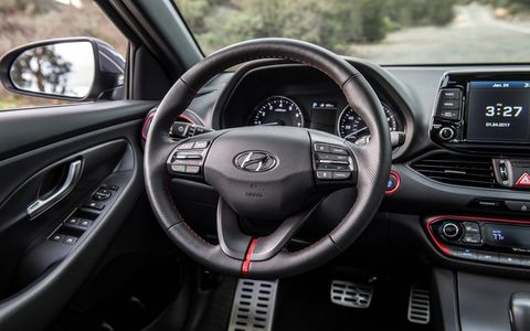 The dash clutter free for the most part and features an eight-inch touchscreen sitting on top.