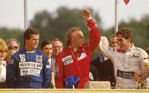 Senna, right, placed third in the 1984 British Grand Prix. He is shown with second-place finisher Derek Warwick, left, and winner Niki Lauda. Senna had replaced Warwick as the driver for the Toleman team.