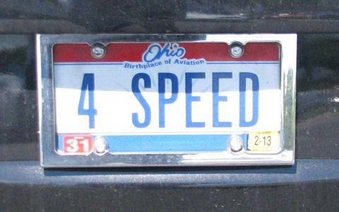 Motor vehicle, Automotive exterior, Text, Vehicle registration plate, Electric blue, Gas, Number, Paint, Symbol,