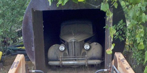 Jerry Brummett couldn't fix up his 1940 Packard Super 8 Formal Sedan, so he stashed it in an old gasoline tank -- for 44 years.
