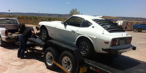 The Datsun lay broken on a trailer.