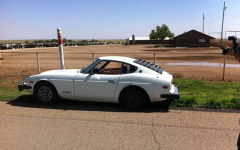 The Datsun 280Z along the side of the road.