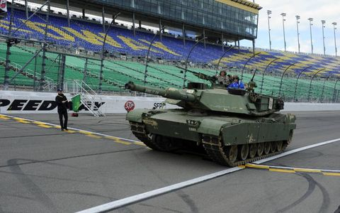 Ready, Set, Pave! // NASCAR Sprint Cup Series driver Brad Keselowski helps kick off the repaving of Kansas Speedway in a Kansas Army National Guard tank.