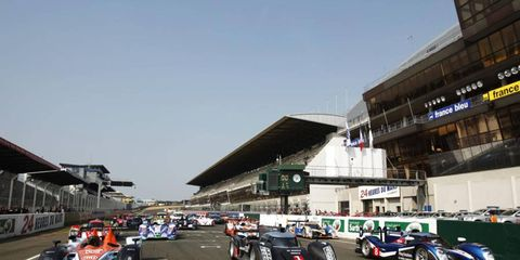 The Aston Martin AMR, Audi R18 TDI and Peugeot 908 line up on the grid at the Circuit de La Sarthe in France on April 24. Photo by: Drew Gibson/LAT Photographic
