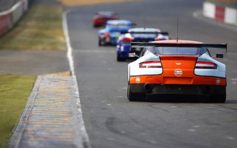The Aston Martin Vantage of Gulf AMR Middle East follows a train of cars down the front stretch at the Circuit de La Sarthe. Photo by: Staley/LAT Photographic