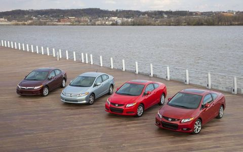 The 2012 Honda Civic family of cars. From left to right: The Civic EX-L, the Civic Hybrid, the Civic EX coupe and the Civic Si coupe