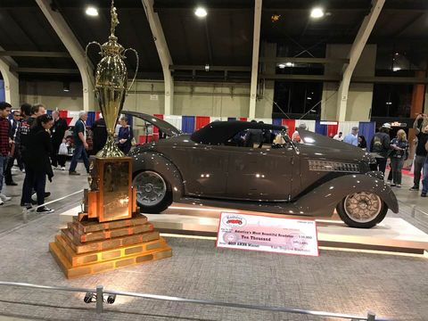 Poteet's roadster and the nine-foot-plus-tall trophy.