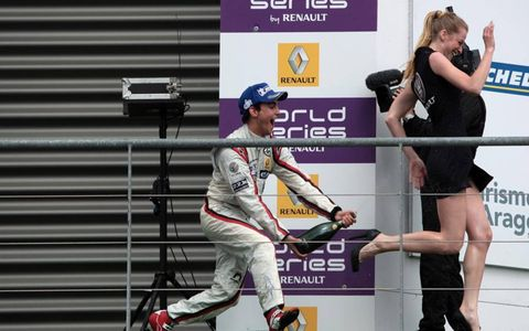 Skirt chaser: Spain's Albert Costa celebrates a podium finish in the World Series by Renault at Spa-Francorchamps. Photo by LAT Photographic