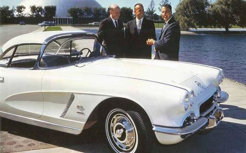 Astronaut Alan Shepard, center, stands with GM Styling President Bill Mitchell, left, and Chevrolet General Manager Ed Cole with Shepard's 1962 Corvette at GM's Technical Center in Warren, Mich.