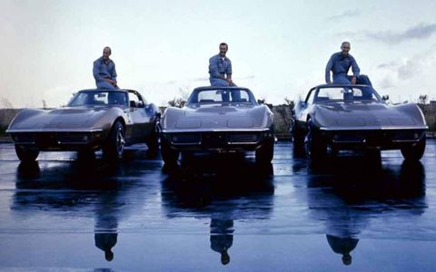 Apollo 12 astronauts Charles 'Pete' Conrad Jr., Richard Francis Gordon Jr., and Alan LaVern Bean were photographed with their identical 1969 Corvette Stingray coupes. The coupes feature a 390-hp, 427 V8 and black-accented Riverside Gold color scheme designed by Bean.