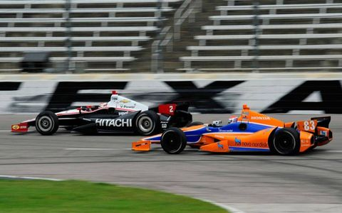 Ryan Briscoe, left, leads Charlie Kimball during a test session at Texas Motor Speedway.