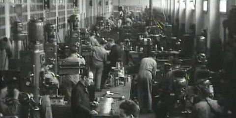 Ferrari workers busily prep for the 1953 Mille Miglia. Compared to today's plant, the shop looks cramped and cluttered.