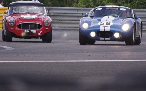 Cobra Daytona Coupe (right) takes on an Austin-Healey