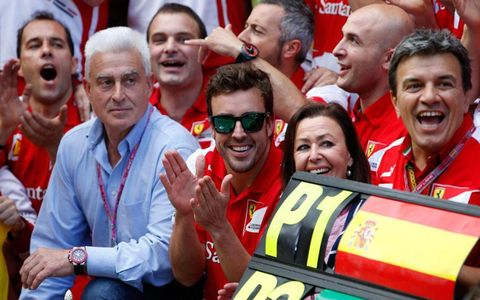 Fernando Alonso leads the cheers for the Ferrari team after  his win in Barcelona on Saturday.