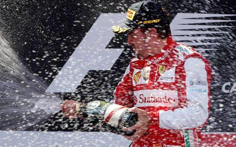 Fernando Alonso celebrates on the podium in Barcelona on Sunday.