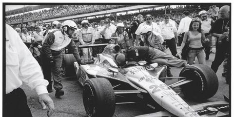 """Only Michael knows for sure, but could this be an homage to the famous """"kiss"""" Andy Granatelli laid on his father, Mario? This win marks the first time an Andretti has been in the Speedway's Winner's Circle since 1969."""