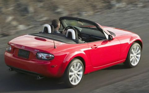 The MX-5 is powered by a 2.0-liter, I4 which produces 170-hp, and 140-lb-ft of torque. The redesigned MX-5 is bigger in every dimention than the model it replaces. Mazda has made folding the roof as simple a task as we've seen in any roadster. All one needs do is unhook one latch and push the top straight back. It drops easily into its fully folded position behind the headrests and automatically locks into place; it doesn't even require a separate tonneau cover.