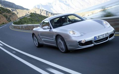The coupe is powered by a 3.4-liter 295-hp flat-six which provides 251 lb-ft of torque between 4400 and 6000 rpm. Weighing 3152 pounds, the Cayman S boasts a power-to-weight ratio squarely centered between the Boxster and 911. Porsche claims 0 to 62 mph (100 km/h) in 5.4 seconds and a 171-mph top speed. The two-seat Cayman S slots into the Porsche line slightly above the new 2005 Boxster, and in doing so it bucks Porsche tradition of pitching coupes at a lower price point than their more complex convertible siblings.