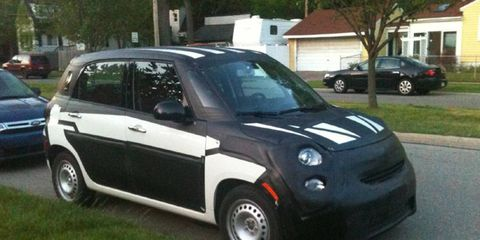 Even under camouflage, the 500L resembles its smaller three-door cousins