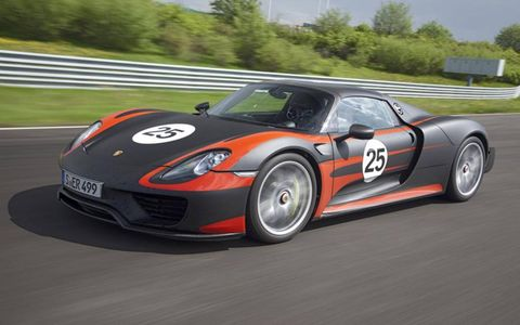 The 918 Spyder adorns a somewhat familiar and largely unadorned profile, reminiscent of the prior Carerra GT.