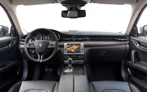 The Maserati Quattroporte has a cozy, handcrafted feel, but it does come with some ergonomic flaws, such as the too-close proximity of the indicator/wiper wand to the left shift paddle.