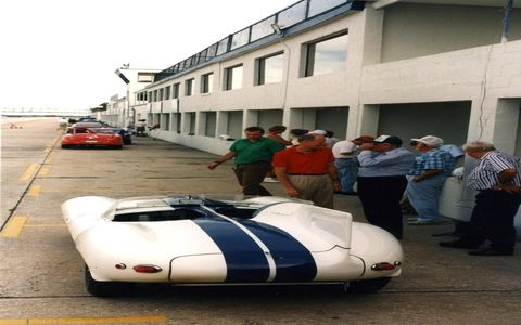 """XK-SS 710 during its Walter Hill period, in the guise of a Cunningham """"long-nose"""" D-type. With Hill (right) is Mike Dale, head of Jaguar's U.S. sales division when this picture was taken at Sebring in 1996."""