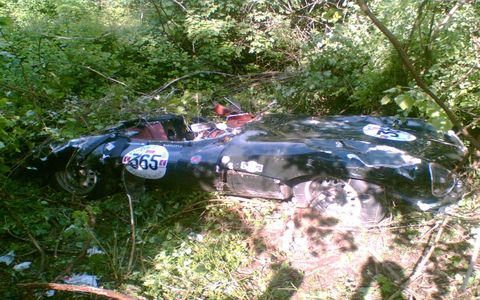 The car has been righted to allow the occupants to escape. The rubber bag-tank used by all D-type and XK-SS cars did its duty and prevented fuel leaks.