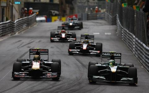 Monte Carlo, Monaco 2010 Heikki Kovalainen, Lotus T127 Cosworth, retired, leads Jaime Alguersuari, Toro Rosso STR5 Ferrari, 12th position, Bruno Senna, HRT F1 F110-02, retired, and Karun Chandhok, HRT F1 F110-02, 15th position.